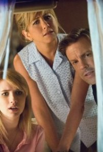 We're the Millers trio looking out camper